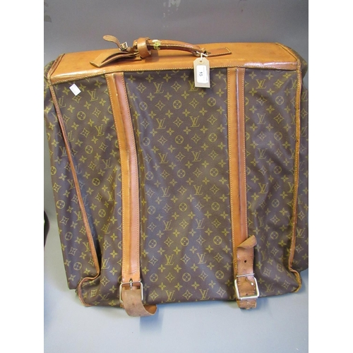 15 - Louis Vuitton, folding suit carrier with leather straps and leather handles (wear from use)...