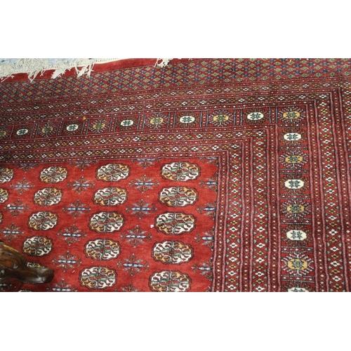 2 - Pakistan Bokhara pattern carpet on red ground...