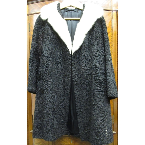 20 - Ladies three quarter length black lambs wool coat, labelled Max Hanky, Zurich, together with another...