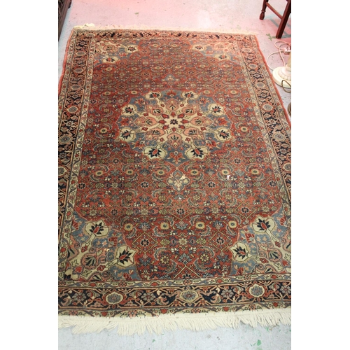 3 - Tabriz rug having central medallion with all-over floral design on a wine ground with multiple borde...