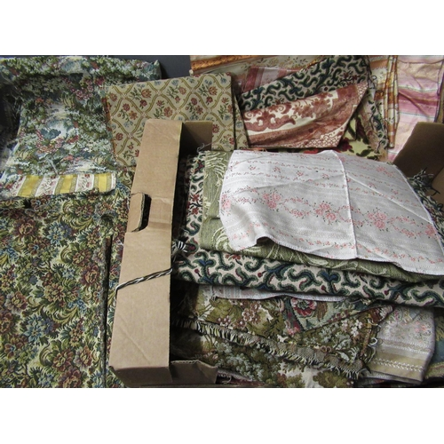 30 - One roll of pink fabric, two boxes containing a large quantity of upholstery / curtain / tapestry fa...