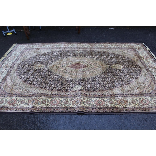 4 - 20th Century machine woven rug having all-over floral design with multiple borders on a gold ground,...