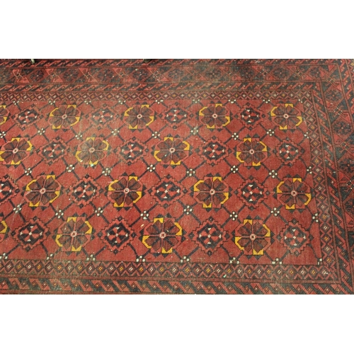 6 - Afghan rug with four rows of twelve gols with multiple borders on wine ground, approximately 84ins x...