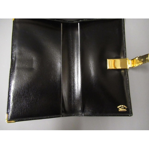 60 - Gucci black leather clutch wallet, 1970's, in original box...