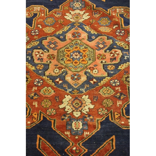 7 - Kurdish rug with lobed medallion design on a royal blue ground with three guard stripes, 6ft x 3ft 1...