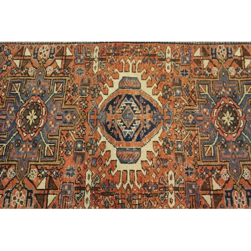8 - Karaja rug with a triple medallion and all-over stylised design on a rose ground with triple border,...