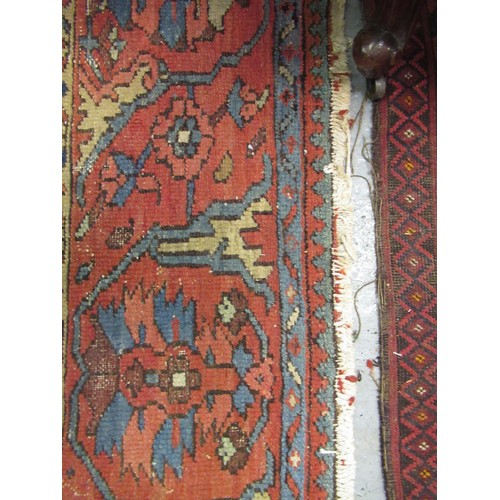 10 - Antique Heriz carpet with a typical medallion and all-over stylised floral design on a brick red gro...
