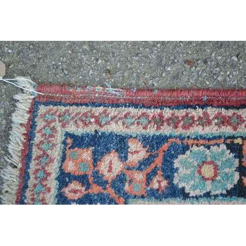 11 - Saruq rug with centre medallion and floral design on rose ground with borders, 6ft 8ins x 4ft 6ins a...