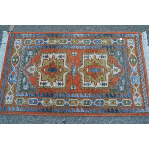 12 - Small machine woven Persian design rug with twin medallion design, 3ft 8ins x 2ft 4ins approximately...