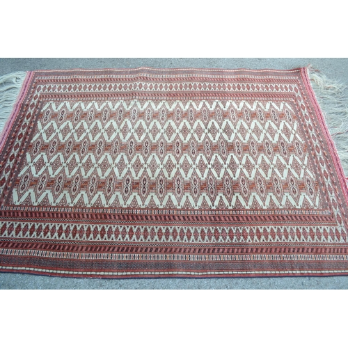 13 - Good quality mid to late 20th Century Tekke rug with multiple gol design on an ivory ground with mul...