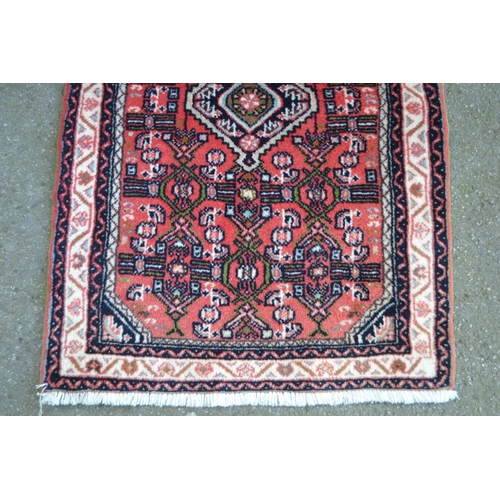 14 - Small Hamadan mat with medallion and Herati design on a rose ground with borders, 3ft x 2ft approxim...