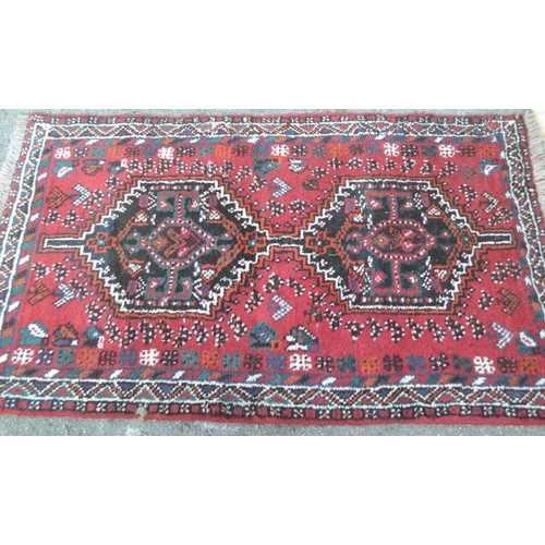 19 - Small Shiraz rug with a twin pole medallion design on red ground with borders, 5ft x 3ft 8ins approx...