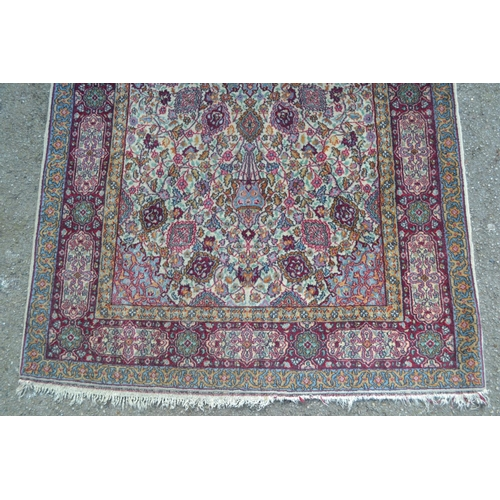20 - Small Sparta rug with a medallion and all-over floral and vase design on ivory ground with borders a...