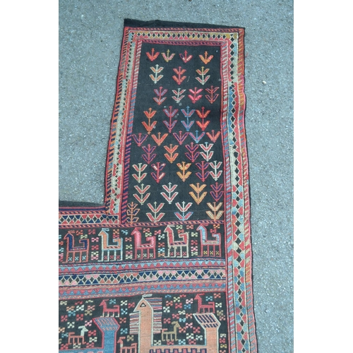 21 - Soumak Caucasian horse rug of irregular form worked with various stylised animal and flower designs ...