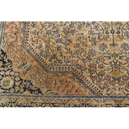 24 - Indo Persian rug with a medallion and all-over floral design on an ivory ground with borders, 8ft x ...