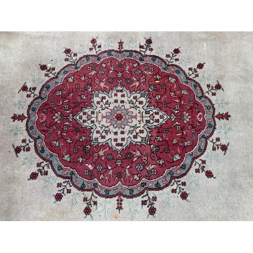 27 - Large Sparta carpet with a pink medallion and swag design on an ivory ground with borders, 15ft 6ins...