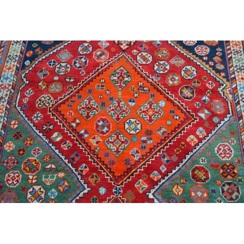 3 - North West Persian rug with twin polychrome medallion design and borders, 6ft 6ins x 4ft 8ins approx...
