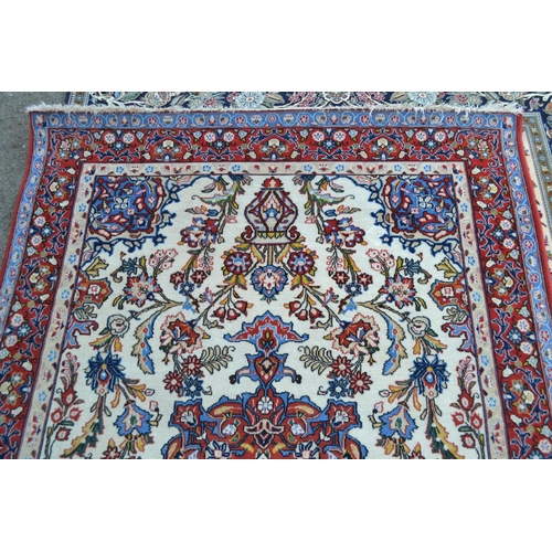 30 - Mid 20th Century Tabriz rug with a medallion vase and floral design on ivory ground with borders, 7f...
