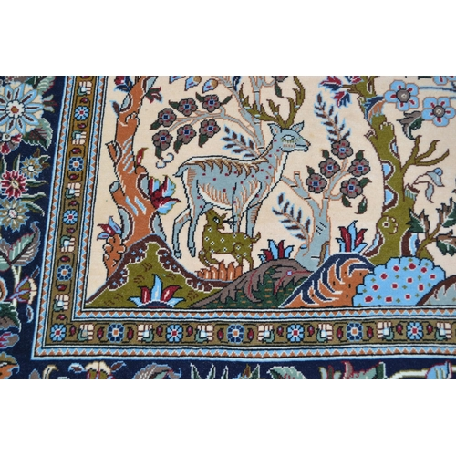 31 - Modern Qum style rug with a tree of life design on an ivory ground with floral borders, 8ft 6ins x 5...