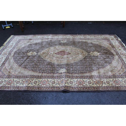 39 - 20th Century machine woven rug having all-over floral design with multiple borders on a gold ground,...