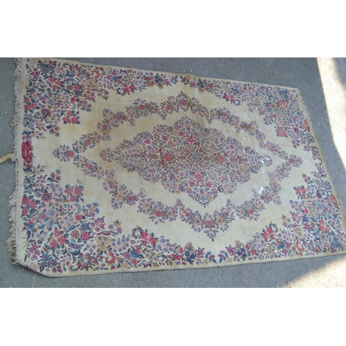 40 - Pair of small Indian carpets, each with a medallion and floral design on an ivory ground, each 10ft ...
