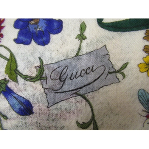 43 - Gucci wrap and a small quantity of various scarves