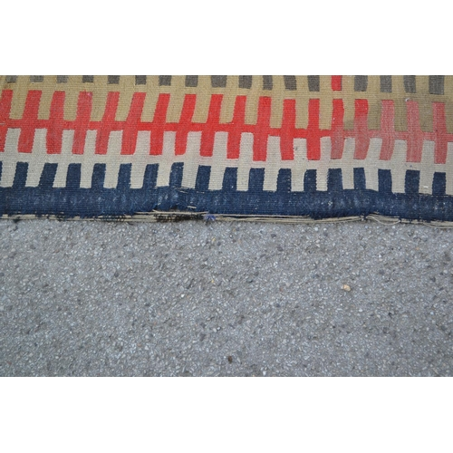5 - Large antique Kelim runner woven with a stylised interlocking band design, 17ft x 4ft approximately ...