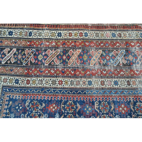 7 - Shirvan rug with blue ground repeating rosette centre panel and multiple borders (various areas of w...