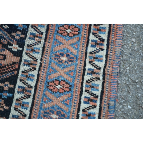 9 - Small Kurdish mat with a repeating serrated leaf centre panel with dark ground and triple border, 3f...