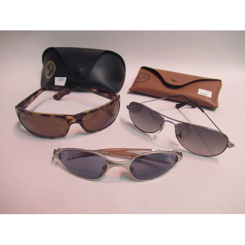 16 - Two pairs of Ray-Ban sunglasses in original cases, together with another uncased pair of Ray-Ban sun...