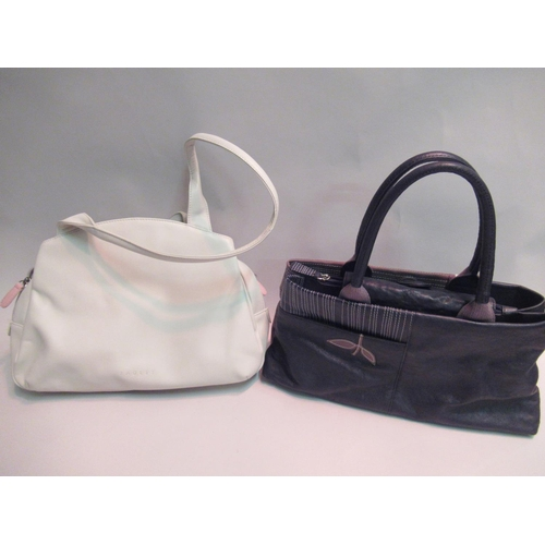 34 - Radley black and tan leather handbag, 13.5ins wide, with dust cover, together with a Radley cream le...