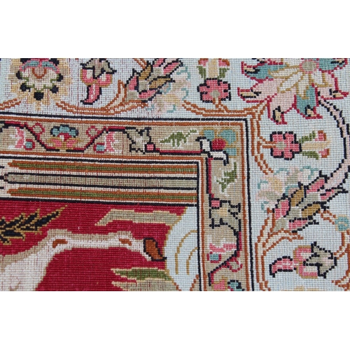 4 - Small modern Turkish silk rug woven with a scene depicting two figures beneath a tree, 37ins x 24ins...