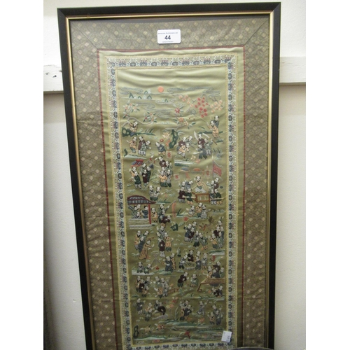 44 - Chinese silk embroidered sleeve panel depicting figures in a landscape, 25.5ins x 12.5ins, framed