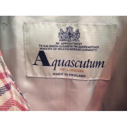 49 - Aquascutum raincoat, in a red, black and cream check design
