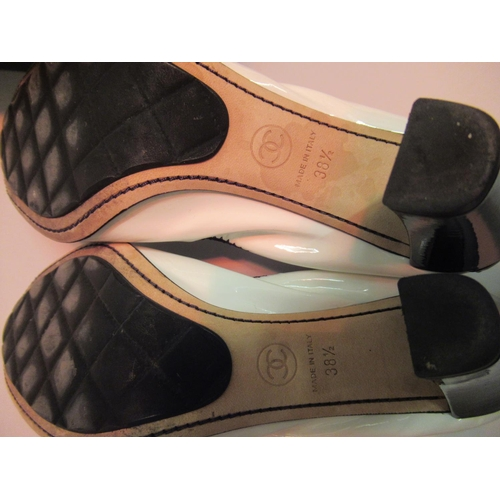 50 - Pair of Chanel white and black patent leather shoes, size 38.5 with original box and dust covers