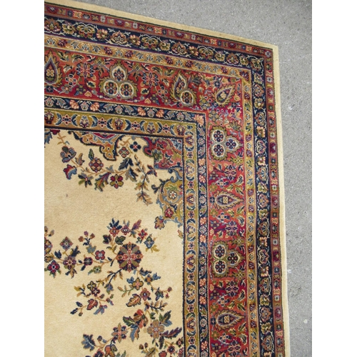 1 - Wilton type machine woven carpet with a medallion and floral design on a beige ground with borders, ...