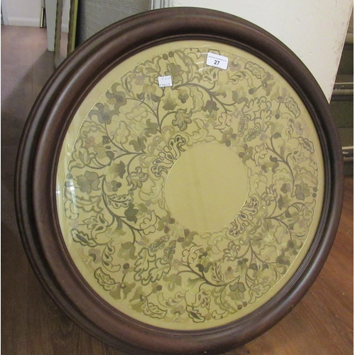 27 - Floral needlework panel worked with silver and gilt thread in a moulded wooden circular frame, 24ins...