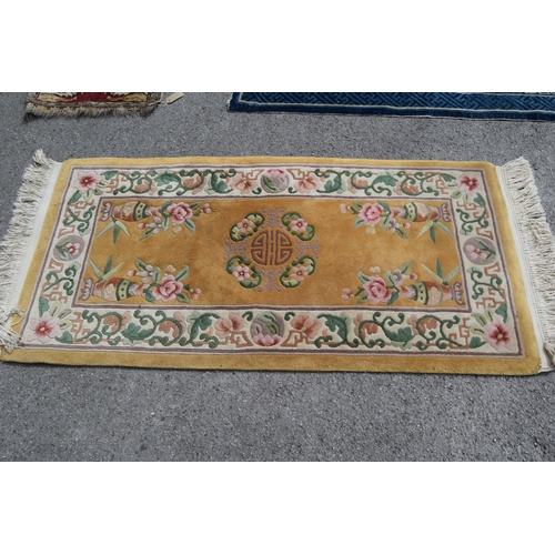 4 - Group of four 20th Century small Chinese rugs and a small earlier prayer rug on red ground with bord...