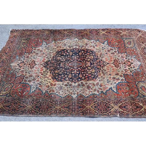 6 - Tabriz rug with a medallion and all-over stylised floral design, with corner designs on an ivory gro...