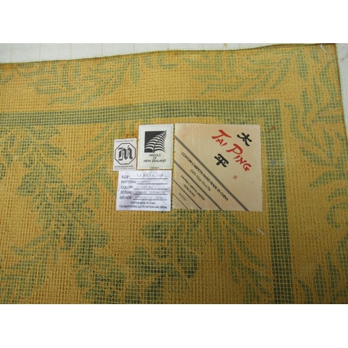 7 - Large modern Chinese machine woven carpet with an all-over blue floral lattice design on an ivory gr...