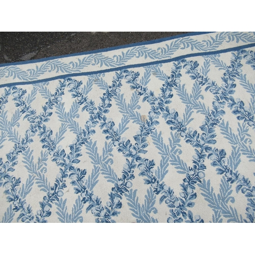 1 - Large modern Chinese machine woven carpet with an all-over blue floral lattice design on an ivory gr...
