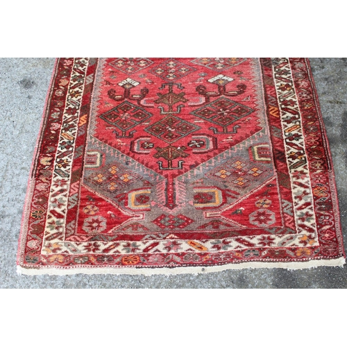 6 - Hamadan rug of geometric design on wine ground, approximately 72ins x 40ins together with a small Ha...