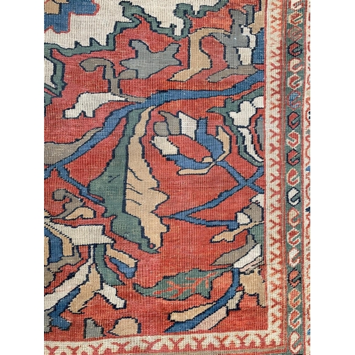 8 - Ziegler Mahal (North West Persian) carpet, the madder filled with bold leafy vines and palmettes, la...