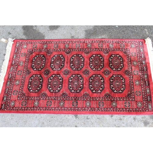 9 - Small Turkish rug together with a small machine made Bokhara rug