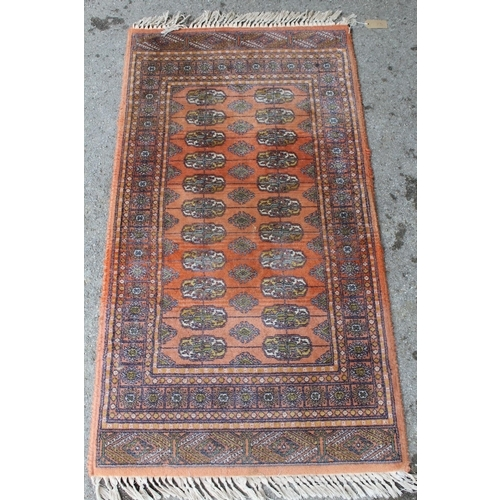13 - Pakistan runner of Turkoman design, 6ft x 2ft approximately together with a similar smaller rug...
