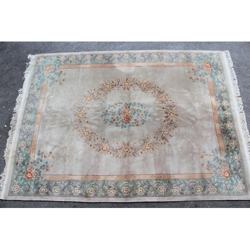 1 - Chinese carpet with a central oval floral medallion on a beige ground with borders, 12ft x 9ft appro...
