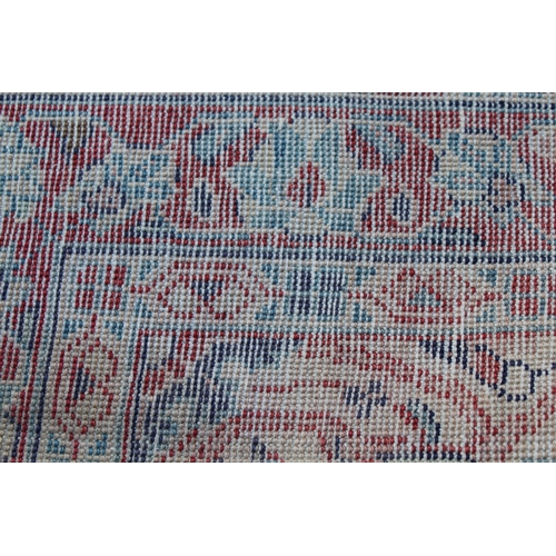 10 - Sarouk Mahal rug with floral design on blue ground with borders, 3.6m x 1.2m