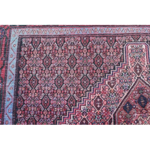 12 - 20th Century Senneh style rug with a lobed medallion and all-over Herati design with borders, 5ft 6i...