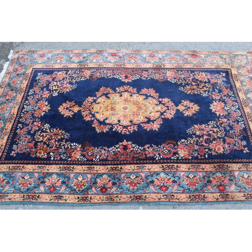 13 - 20th Century Kirman part silk rug with a lobed floral medallion and stylised floral design on a midn...