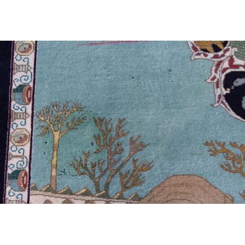 14 - Modern Qum pictorial rug depicting figures, animals and buildings in a landscape within a conforming...